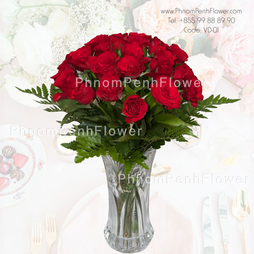2 Dozen red roses in glass vase